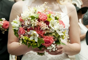 bride holding bunch of flowers at wedding