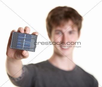 Man Holds Solar Panel