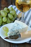 piece of  blue cheese, grapes and cheese knife