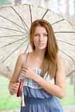 Beautiful young girl with parasol