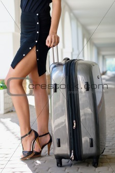 Beautiful girl with luggage