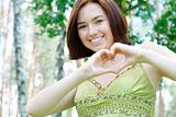 Girl with a heart sign