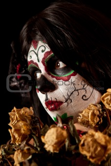 Portrait of Sugar skull girl with dead roses