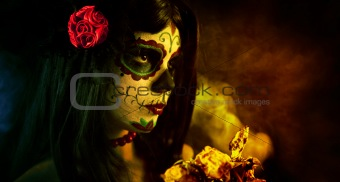 Artistic shot of sugar skull girl with dead roses