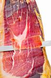 cutting serrano ham