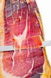 cutting serrano ham