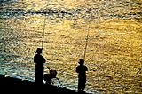 Fisherman silhouette  on shoreline