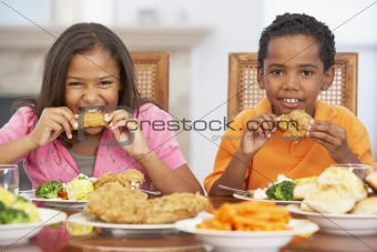 Brother And Sister Having Lunch Together At Home