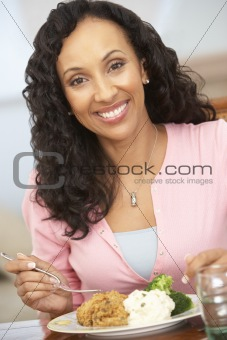 Woman Enjoying A Meal At Home