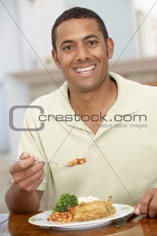 Man Enjoying A Meal At Home