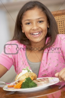 Young Girl Enjoying A Meal At Home