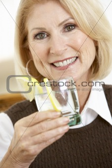 Woman Having A Drink At Home