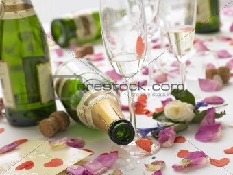 Empty Wine Bottles Among Rose Petals