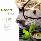 Asian teapot with green tea selection