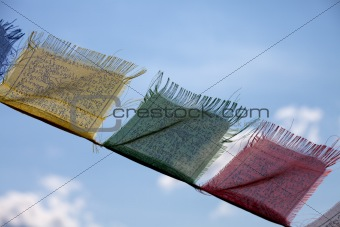 tibetan flags and a cloudy sky
