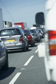 Cars Lined Up In A Traffic Jam On A Highway