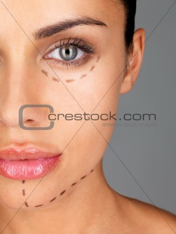 Attractive caucasian woman whose face is marked