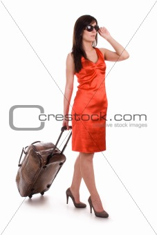 Beautiful woman going on vacation with suitcase.