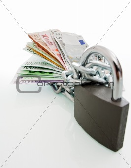 Banknotes chained and locked