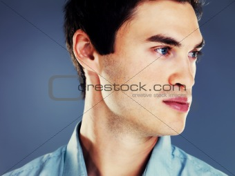 Closeup portrait of a handsome young man thinking