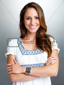Portrait of a beautiful young woman standing with folded hand