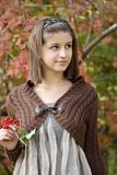 Young girl in the autumn forest