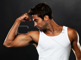 Handsome muscular man flexing his biceps