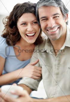 portrait of  mature couple sitting together and smiling