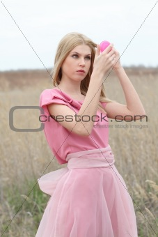 Beautiful blond girl in pink