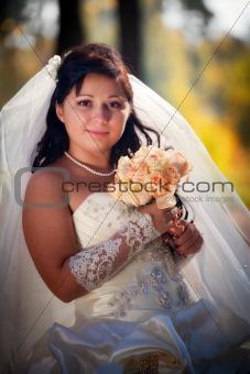 Bride in autumn park