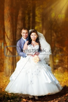 Newlyweds portrait in autumn park
