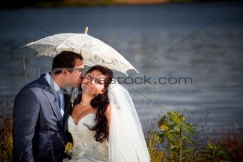 Newlyweds near autumn lake