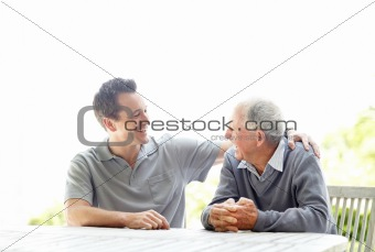 Portrait of a handsome young man sitting with his father