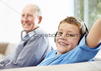 Closeup of a cute small boy listening to music on headphones