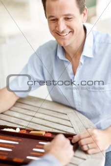 Portrait of happy young man enjoying a game