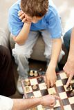 Top view of young boy busy playing chess