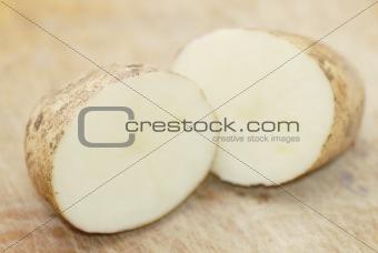 One Kestrel potato cut in half.