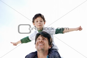 Boy enjoying a ride on his father shoulder