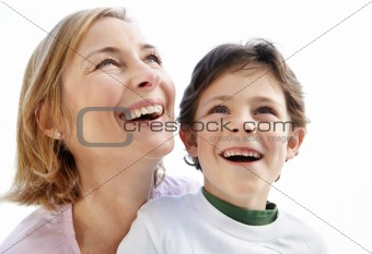 Young woman and her son looking at something interesting