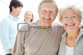 Portrait of happy senior couple smiling
