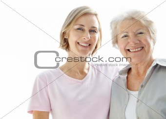 Happy young woman standing with her mother