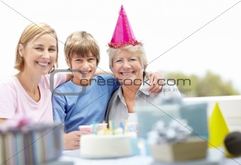 Old woman celebrating her birthday with her family