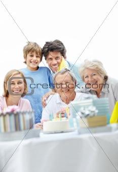 Mature male celebrating his birthday with his family