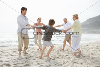 Cute family playing on the beach