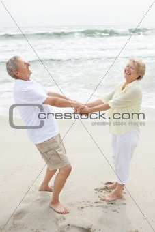 Portrait of a happy mature couple playing