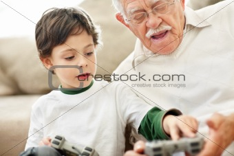Portrait of little boy helping his grandfather
