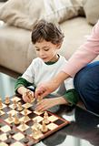 Portrait of cute little boy and his grandmother playing