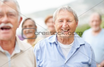 Retired aged man laughing outside
