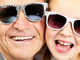 Small girl and her grandfather in sunglasses
