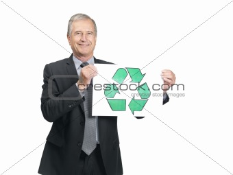 Happy senior male entrepreneur holding recycle symbol